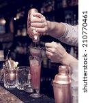 bartender is straining cocktail ... | Shutterstock . vector #210770461