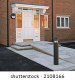 Entrance to apartments with ramp - stock photo
