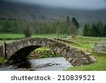 Stone Bridge Crosses A Stream...