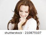 attractive young woman in a... | Shutterstock . vector #210875107