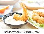 shrimp fritter on dish.   Shutterstock . vector #210882259
