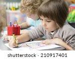 two kids drawing at kindergarten | Shutterstock . vector #210917401