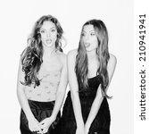 two beautiful girls having fun. ...   Shutterstock . vector #210941941