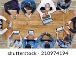 Stock photo group of business people using digital devices 210974194