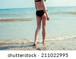 a young woman in swimwear is... | Shutterstock . vector #211022995