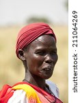 Small photo of LILIIR, SOUTH SUDAN- DECEMBER 4 2010: Unidentified Dinka woman with tribal scarification in South Sudan