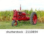 Antique Red Tractor In Front O...