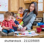 a mother in the kitchen plays... | Shutterstock . vector #211235005