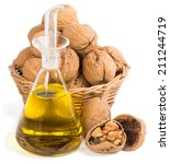 Small photo of Walnut oil and nuts in a basket isolated on a white background