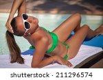 beautiful female model posing... | Shutterstock . vector #211296574