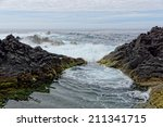 Rocky Coast With Moss In Azore...