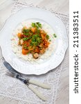 Small photo of Turkey stew with rice, pumpkin and tomato sauce