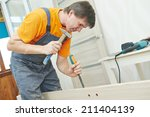male carpenter at interior wood ... | Shutterstock . vector #211404139