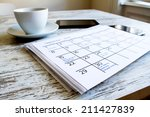checking monthly activities and ... | Shutterstock . vector #211427839