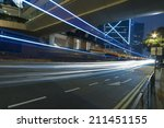 traffic at night in hong kong  | Shutterstock . vector #211451155