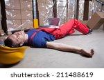 unconscious warehouse worker...   Shutterstock . vector #211488619