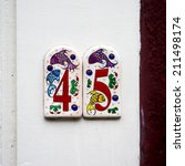 house number forty five on two... | Shutterstock . vector #211498174