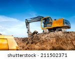 Small photo of construction site digger, excavator and dumper truck. industrial machinery on building site