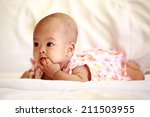 asian baby girl lying and... | Shutterstock . vector #211503955