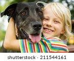 happy young boy lovingly... | Shutterstock . vector #211544161
