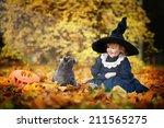 little cute girl in black witch ... | Shutterstock . vector #211565275
