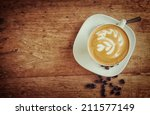 cup of art latte or cappuccino... | Shutterstock . vector #211577149