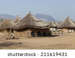 small village of thatched huts... | Shutterstock . vector #211619431