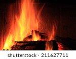 a nice fire in a fire place | Shutterstock . vector #211627711