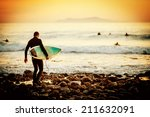 surfer on the beach at sunset | Shutterstock . vector #211632091