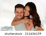 man and woman posing together... | Shutterstock . vector #211636159