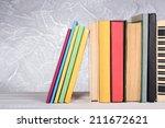 books on wooden table on light... | Shutterstock . vector #211672621