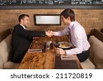 men laugh together while... | Shutterstock . vector #211720819