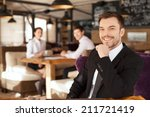 stylish young man sitting in... | Shutterstock . vector #211721419