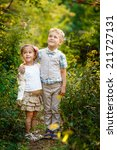 boy with his sister in the park | Shutterstock . vector #211727131