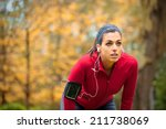Tired Female Runner Taking A...