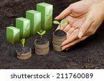 hands holding tress growing on...   Shutterstock . vector #211760089