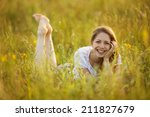 happy cheerful girl lying in... | Shutterstock . vector #211827679