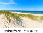 Green Grass On Sand Dune With...