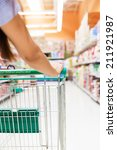 woman with shopping cart in... | Shutterstock . vector #211921987