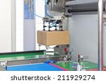 handling packages at automated... | Shutterstock . vector #211929274
