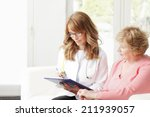 female doctor consulting with... | Shutterstock . vector #211939057