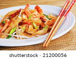 Spicy Shrimp Pad Thai Stir-Fry Rice Noodles with Basil and Bean Sprouts - stock photo