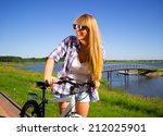 young happy woman is sitting on ...   Shutterstock . vector #212025901