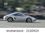 silver race car at a... | Shutterstock . vector #2120423