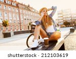 young stylish woman with a... | Shutterstock . vector #212103619