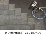 a new roof being applied | Shutterstock . vector #212157409