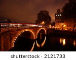Stock photo canals in amsterdam at night photo taken with a long exposure 2121733