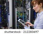 technician using tablet pc... | Shutterstock . vector #212283697
