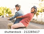 happy mature couple riding a... | Shutterstock . vector #212285617