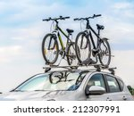 passanger car with two bicycle... | Shutterstock . vector #212307991